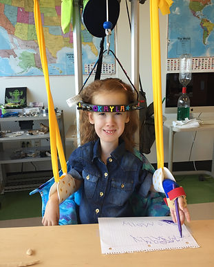 Girl with SMA Type 1 in school