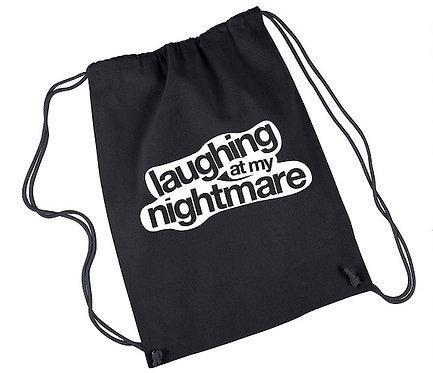 Laughing At My Nightmare Drawstring Bag