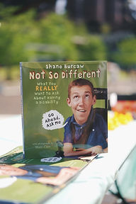 A photo of Shane Burcaw's children's book, No So Different.