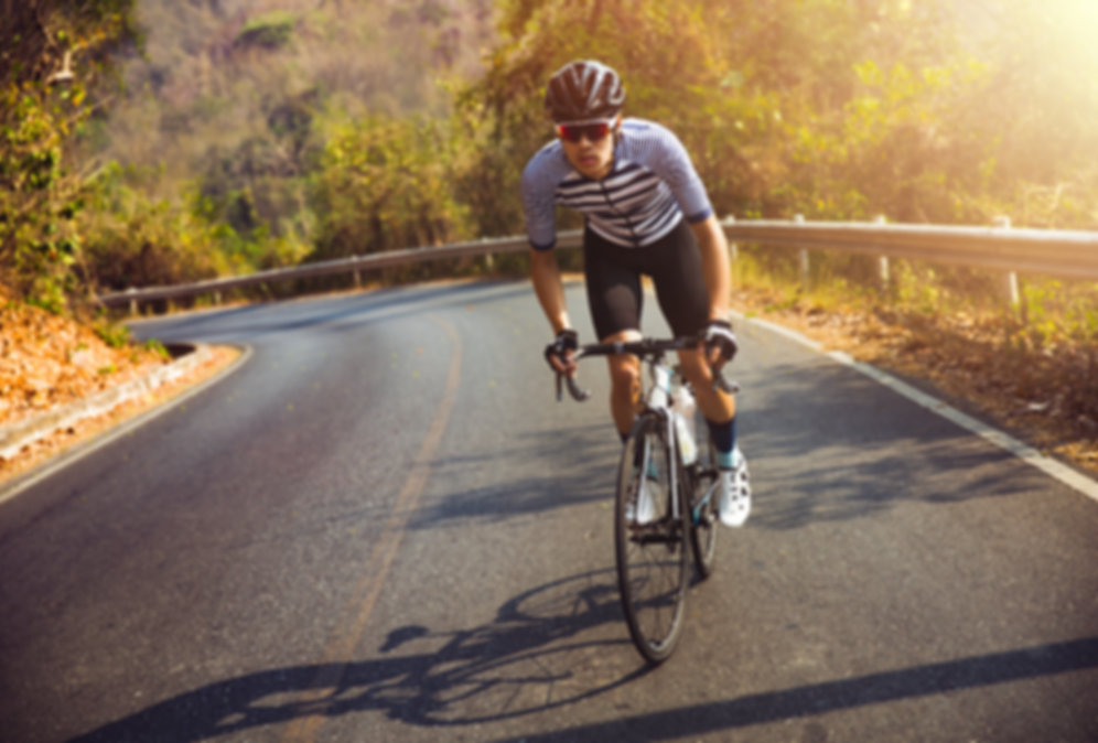 iStock-942488686 handsome cyclist on his