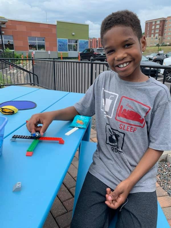 A student holding a lego plane