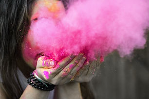 shallow-focus-photograph-of-woman-blowin