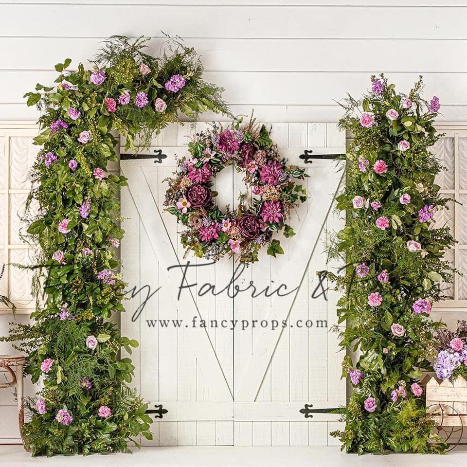 White Barn Door with Purple Flowers