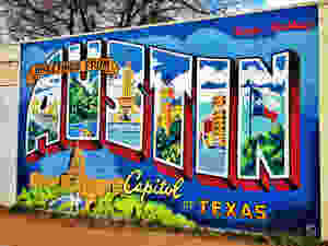 photo depicts a mural that reads Greetings from Austin