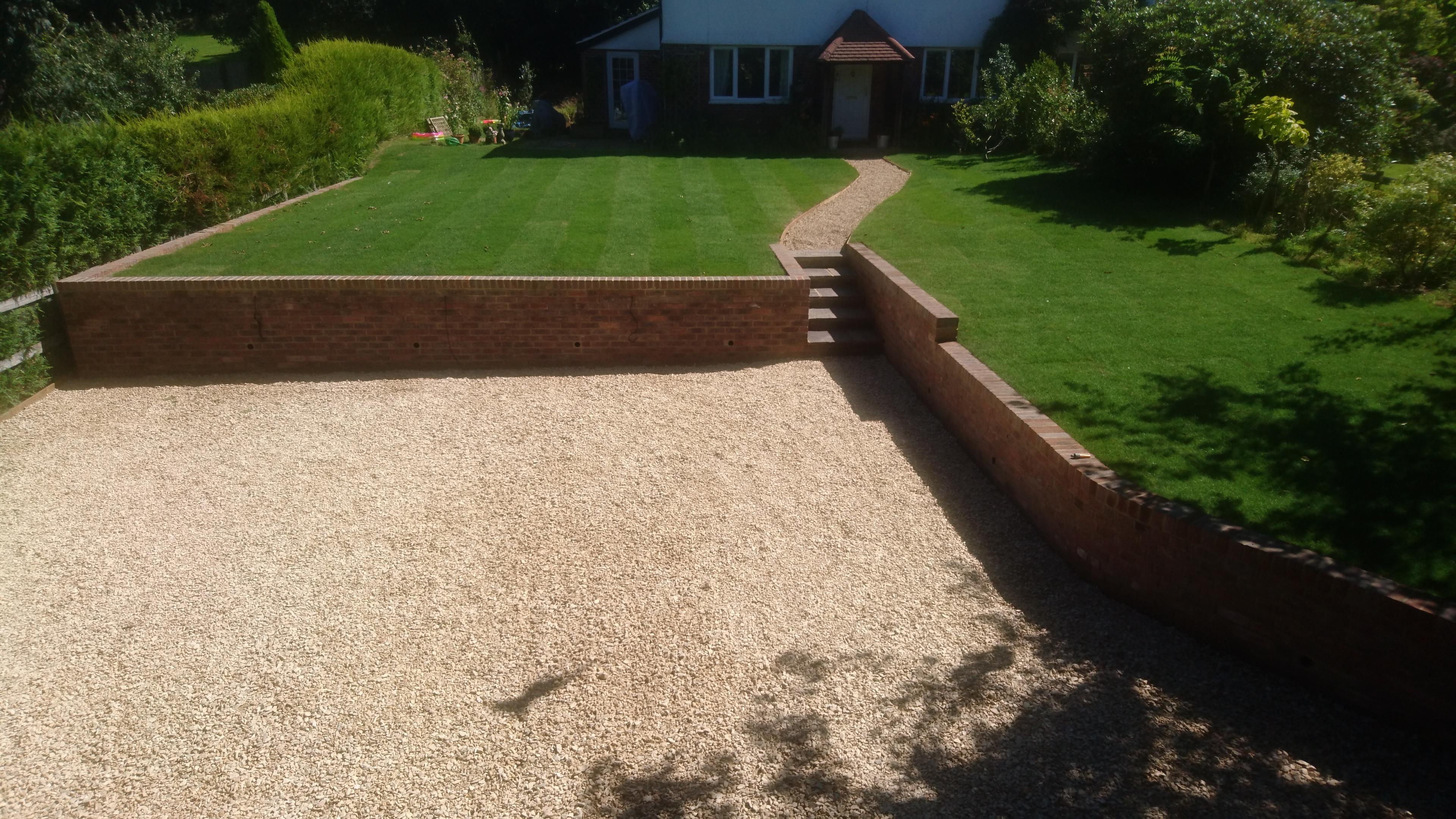 Brick retaining wall and driveway
