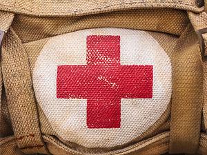 medical aid symbol on a vintage jute arm