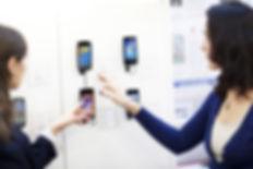Womanchoosingaphone.jpg