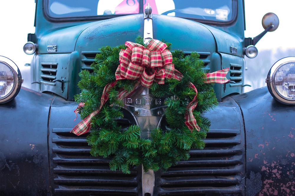 holiday road safety, antique truck with wreath on hood.