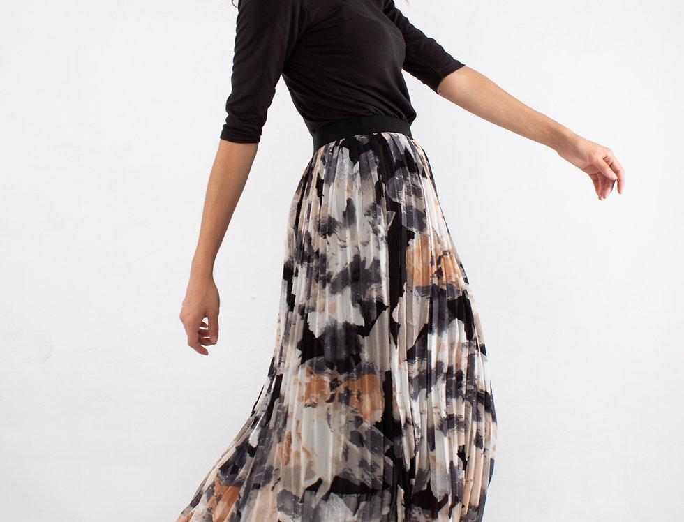 Falda plisada manchas