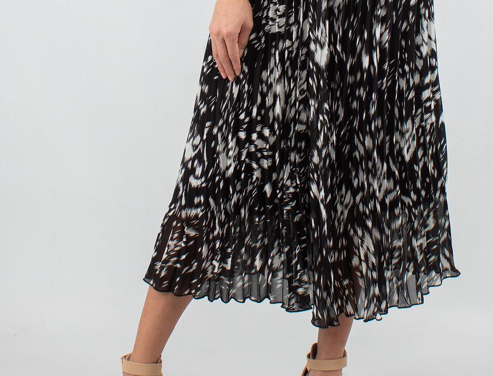 Falda plisada de manchas