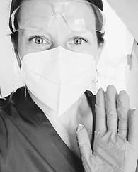 Practitioner, Char Marie, wearing gloves and a medical mask and scrubs, for covid safety