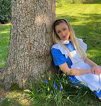 Alice sitting by tree .jpeg