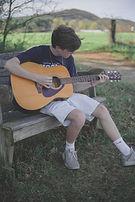 Boy Playing Guitar.jpeg