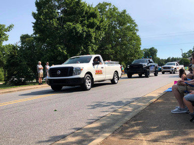 Some Nelon-Cole trucks roll through Lattimore for their 4th of July Parade.