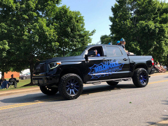 Keith Nelon drives a fantastic truck paint job in the 4th of July Parade.