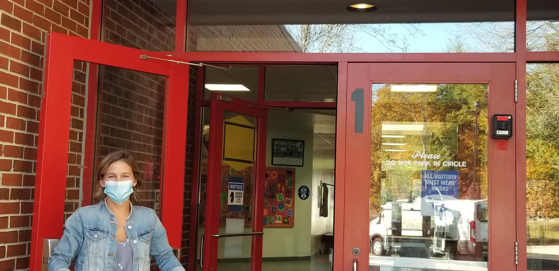 Open Red Door with Volunteer Holding Foo