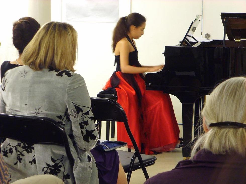 girl playing piano small.jpg