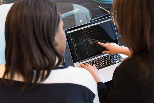 two-women-looking-at-the-code-at-laptop-