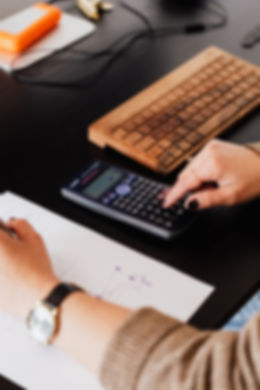 crop-bookkeeper-using-calculator-and-tak