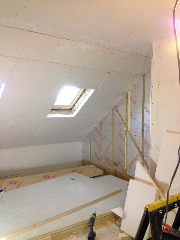 Plasterboard fitted over insulation