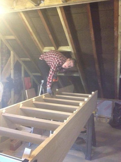 Labourer assisting with staircase