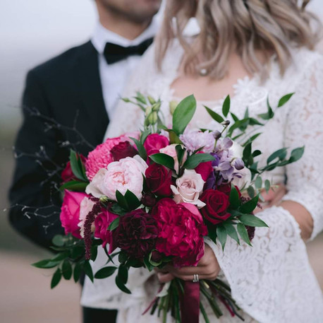 Bride and  groom with Romantic Bridal Bouquet