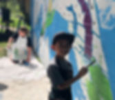 Students Painting Iwa Mele Mural_edited.jpg