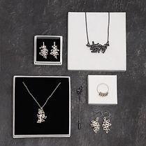 Kinetic jewellery flatlay, Rebecca Kitching