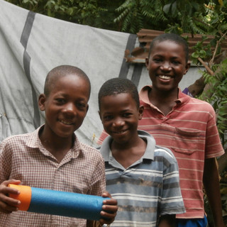 The amount of joy that these young boys experienced when given water squirters from a generous donation was priceless!!