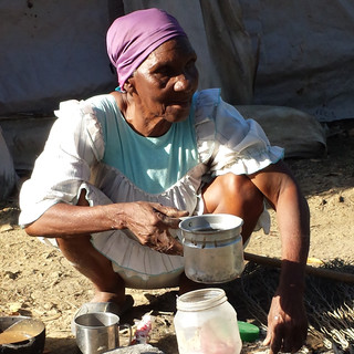 """This old woman who lived in the """"house"""" (pictured next) cooked some amazing home made hot chocolate over her stove (ie. a small campfire) for me every time I visited."""