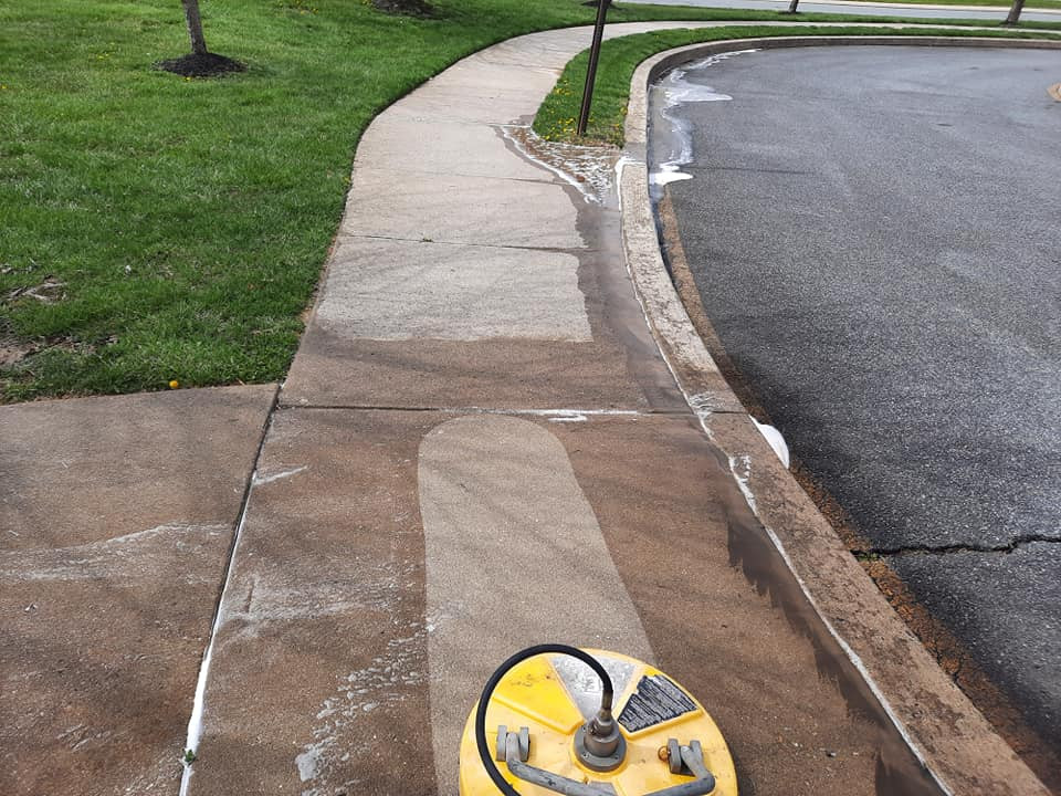 """<img src=""""power washing.png"""" alt=""""power washing a sidewalk using a surface cleaner"""">"""