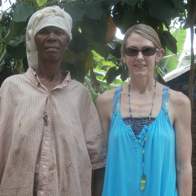 I should not be smiling in this picture ... this poor woman had lost her son to murder by a machete just a few days prior to this day. When I met her, her son was lying dead in a makeshift casket in her yard just a few feet away from us and she was taking care of her two young grandchildren that her son had left behind. Slaying others is a truly horrific reality in Haiti and happens without consequence to the majority of perpetrators.