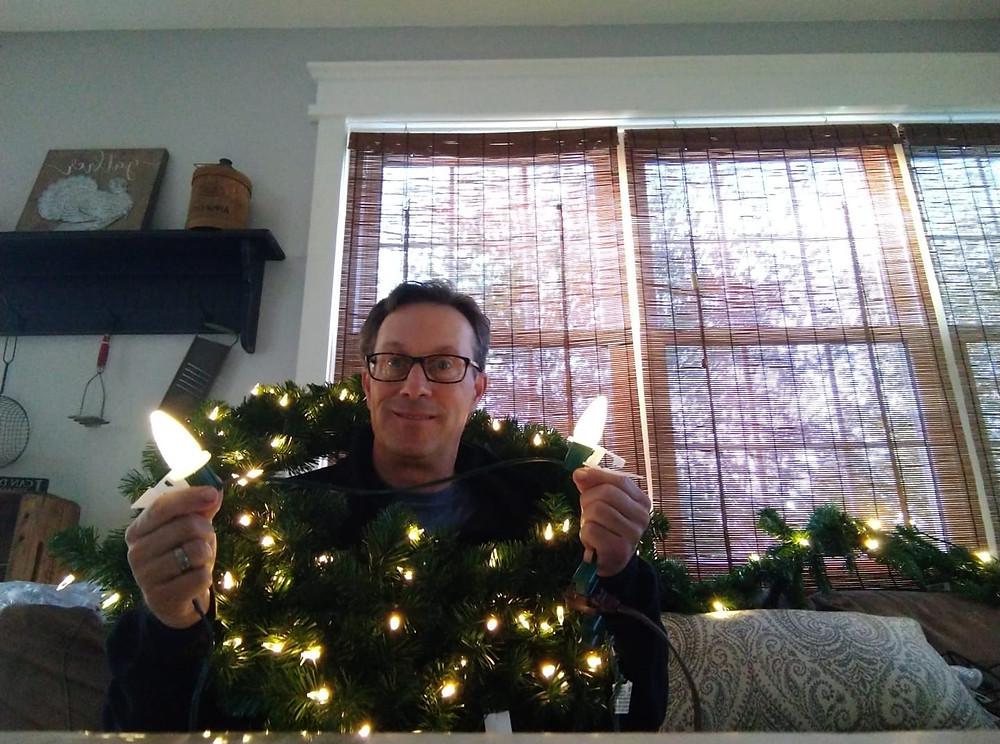 "<img src=""ChristmasLightsonWreath.jpeg"" alt=""Dave wearing a wreath with Christmas Lights"">"