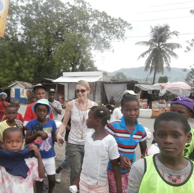 Walking the thirty minute walk to the local school where our Music & Art Program was held each Saturday, picking up chidren as we went. Our very first class had less than five students ... a few months later at least sixty children attended regularly.