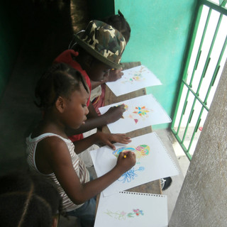 Some of the girls working on their colouring during one of our weekly Music & Art Program classes. For many, this would have been the first time they ever held a crayon ... such a simple thing that we don't even think about here in Canada is such a profound thing to children living in dire poverty.