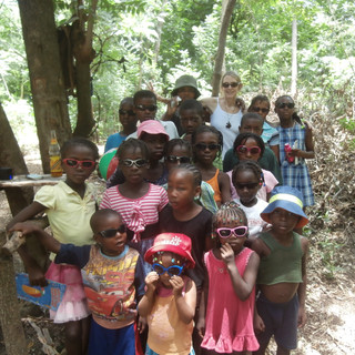 The children wearing sunglasses for the first time ever ... thanks to a generous donation!!