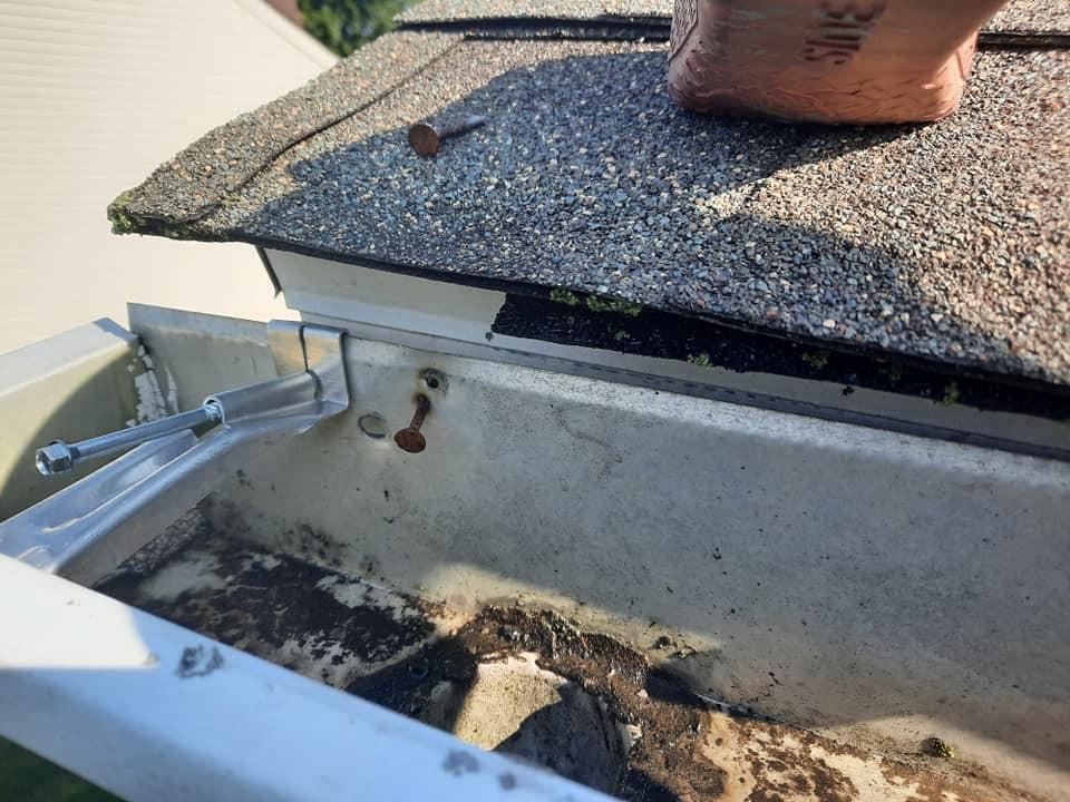 "<img src=""DE Gutter Cleaning.png"" alt=""Cleaning gutters in Delaware>"