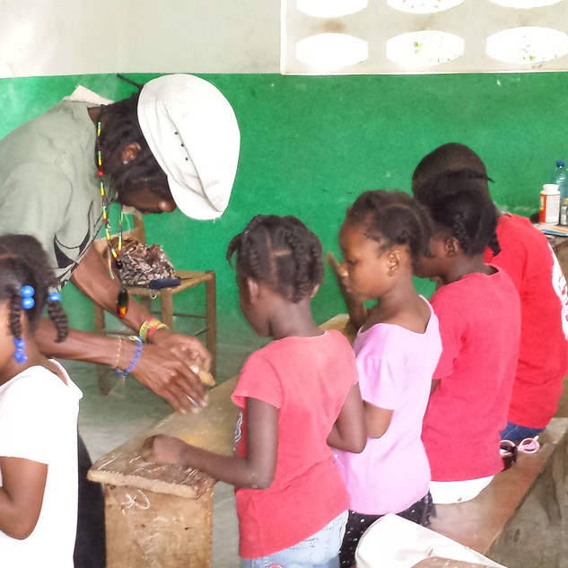 The children learning how to make Cajou (a nut that grows on trees in Haiti) necklaces at our weekly Saturday program. Many people in Haiti earn money by making and selling jewellery, crafts etc.