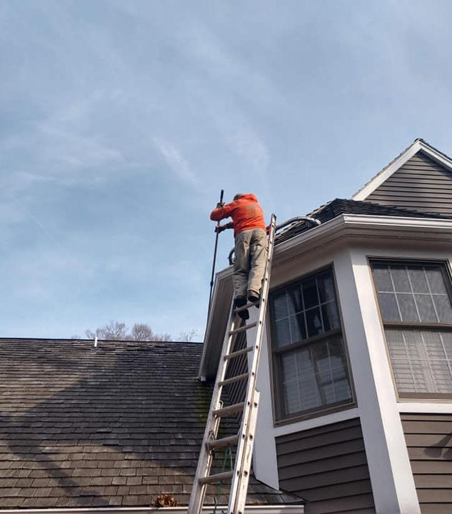 We will go to any heights to wash your roof