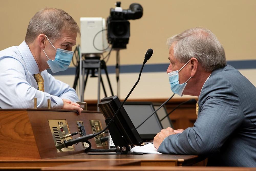 Representative Jim Jordan (R-OH) speaks with Representative Ralph Norman (R-SC) in the U.S. Capitol on September 30, 2020