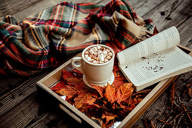 Fall leaves, cocoa, and a book