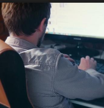 man at computer.PNG