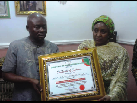 PRESENTATION OF AN AWARD TO HER EXCELLENCY, HAJIYA UMARU MUSA, THE FORMER FIRST LADY OF NIGERIA.