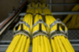 Yellow network cables with assured with cable clips