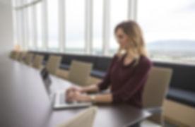 woman in board room.jpg