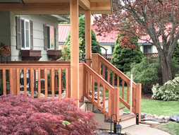 Front porch with new stairs and new railing.