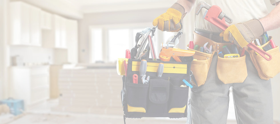 Handyman carrying tools while working on home repairs.