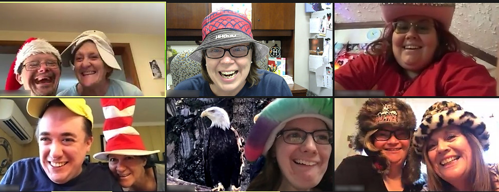 People are shown in virtual tiles, smiling with different hats on.