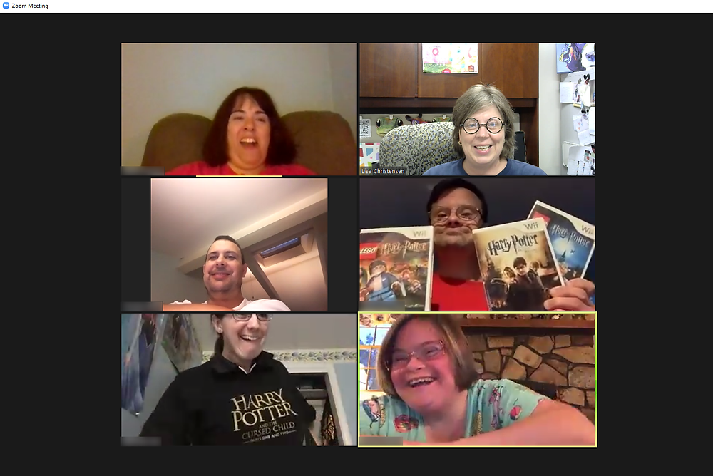 Six people in a virtual meeting, smiling and showing Harry Potter memorabilia.