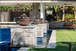 Infinity pool w/ fire bowl pilasters